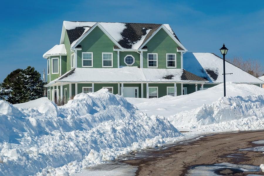 vinyl siding home in winter snow