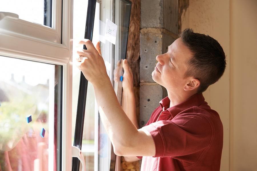 contractor installing windows